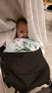 We went shopping, and I thought Thea was napping underneath the blanket in the stroller, until I caught sight of this in a mirror.